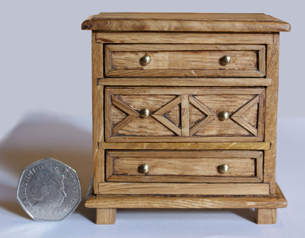 oak chest of drawers dolls house chest stright on with coin 2.jpg