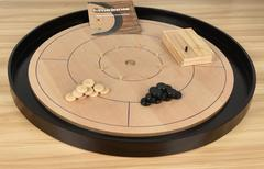 Crokinole - Crokinole is one of the oldest dexterity games out there, and we love it!