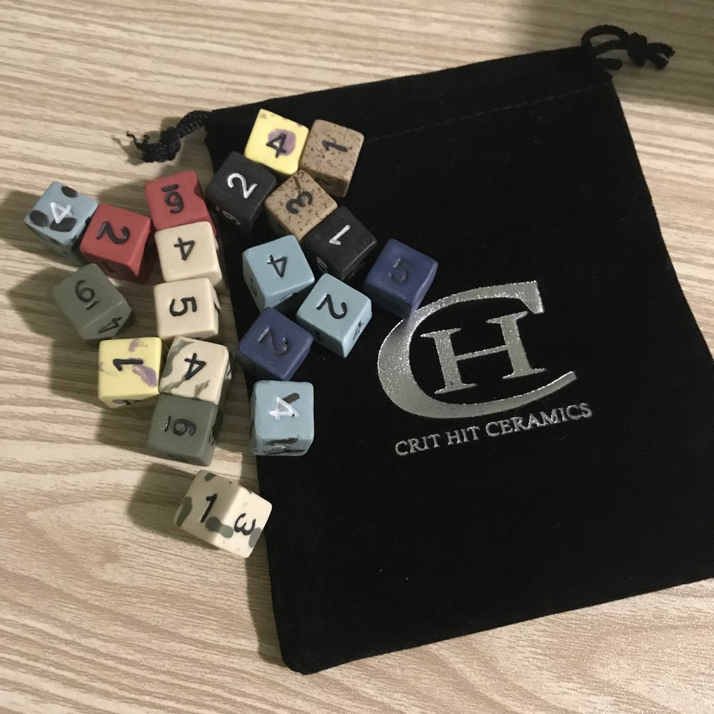 2d6 ceramic dice!   you'll get a pair od 6 sided ceramic dice, you pick from the available colors! From Crit Hit Ceramics  -Cost 2 credits