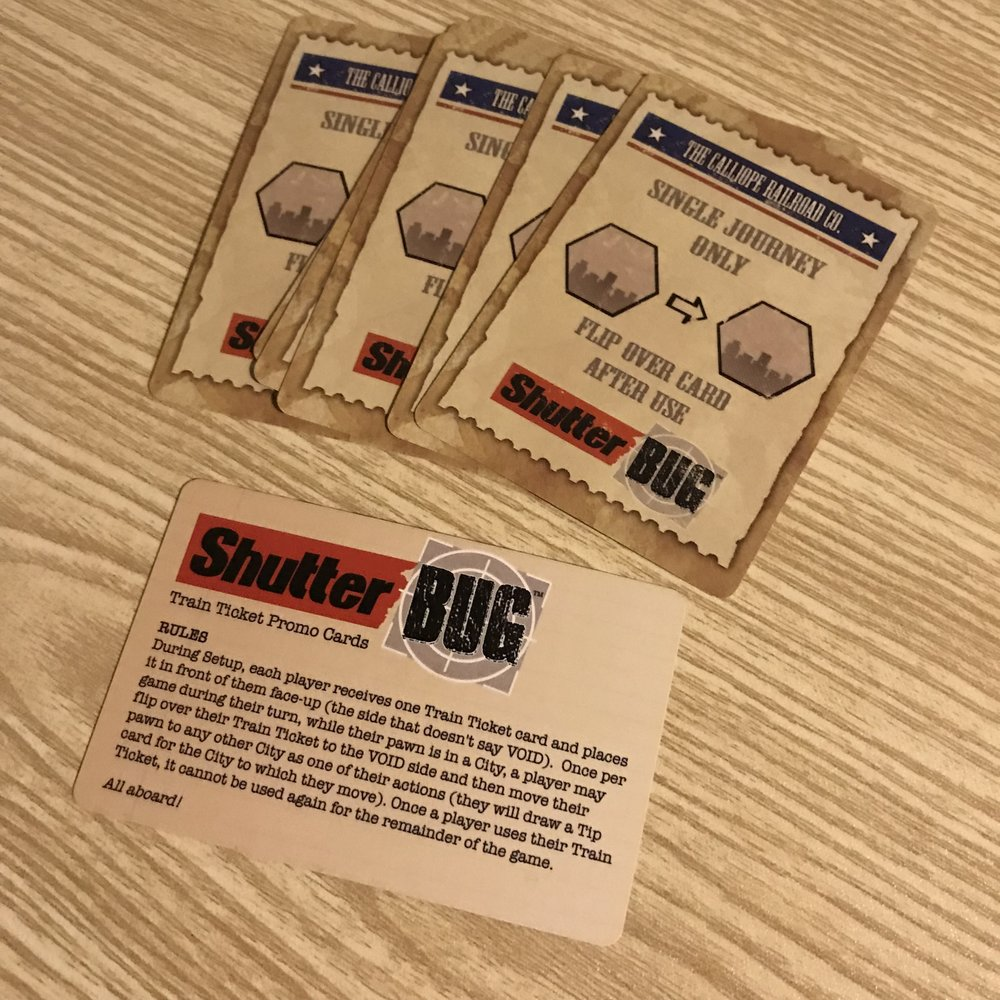 Shutter Bug Promo card set   These Train ticket promos come in a set and each player gets one to start with. From Calliope Games.  -Cost 1 credit