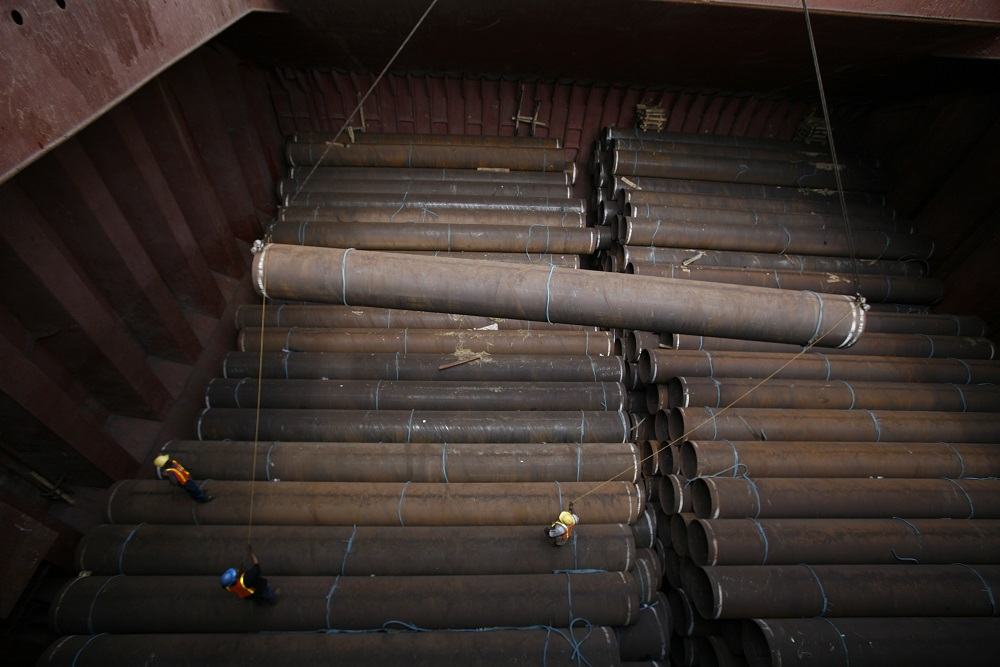 Imported Pipe Being Loaded into Barge