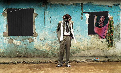 "Bienvenu Mouzieto in the Bacongo neighborhood. Source: NPR ""The Surprising Sartorial Culture Of Congolese 'Sapeurs'"""