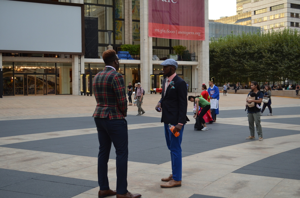 Two having casual conversation at Lincoln Center - New York Fashion Week.