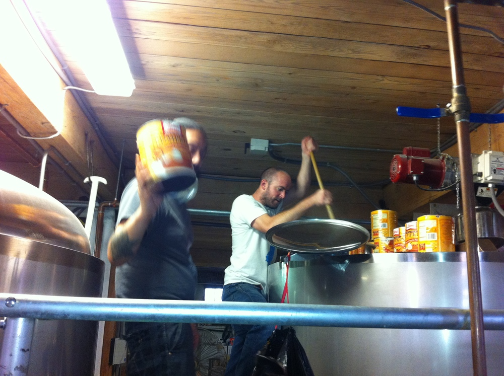 Berto and Chris adding that pumpkin to the mash and stirring the heck out of it...