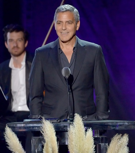Actor George Clooney, Christian Hebel in the background. Photo by Getty Images