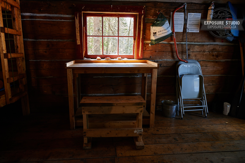 The morning sun glowing through a window of Lost Coin Lake cabin