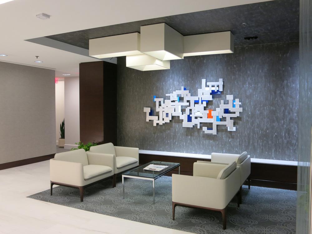 Aluminum and Plexiglas wall sculpture