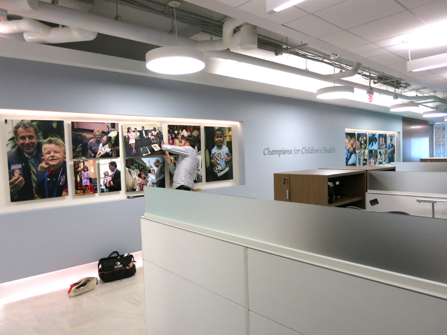 The Mission Wall features two inset areas where photographs printed on aluminum were installed.