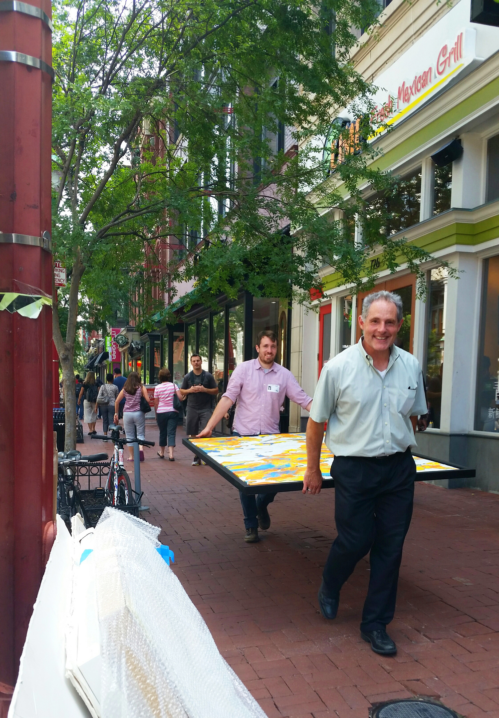 Jack and Andrew carry a large 4x7 foot painting down the streets of Chinatown as part of a slew of artwork we presented to a client.