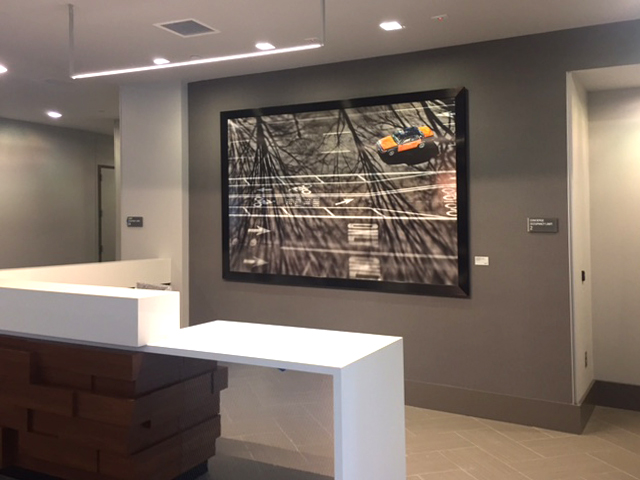 A huge photo of a DC taxicab visually grounds the reception desk.