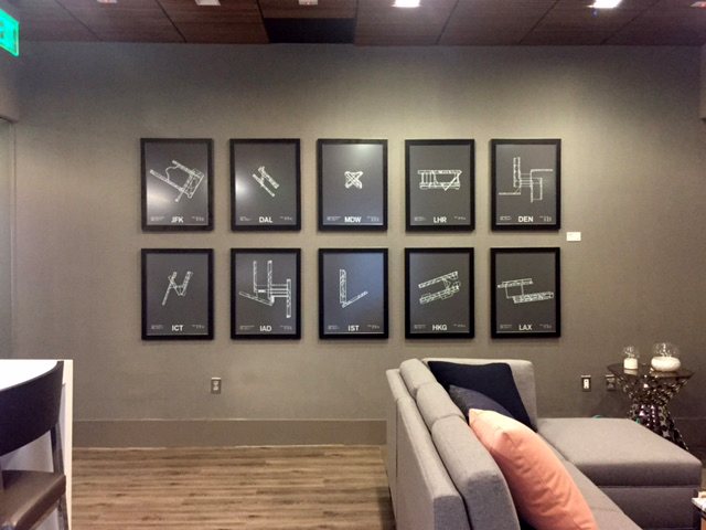 This series of prints, installed in the lounge area, feature the floor plans of airports.