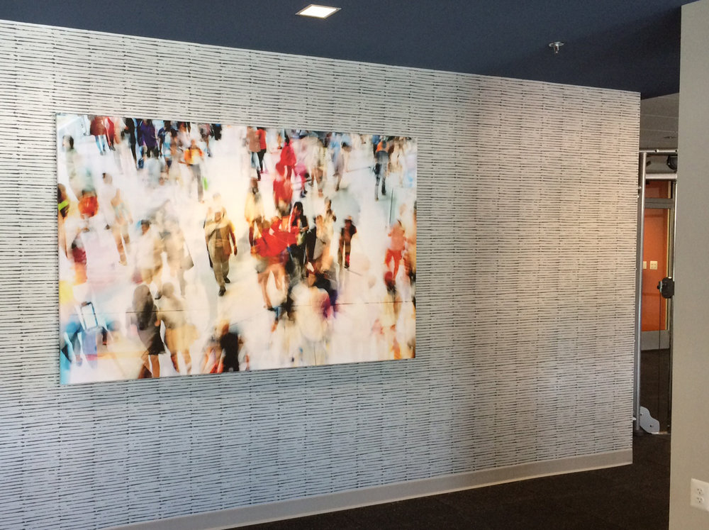 This energetic canvas greets residents when they enter the Fitness Center.
