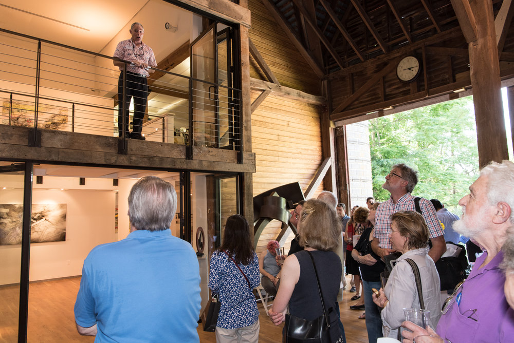 Principal Jack Devine gives a quick introduction about the barn and the artists' work.