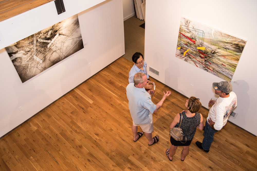 Visitors enjoy speaking with artist Chee Keong about his process.