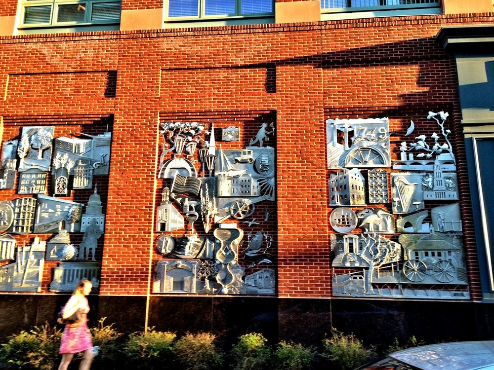 This install involved mounting over 60 individual aluminum sculptures to a three 8'x12' brick niches in Alexandria.