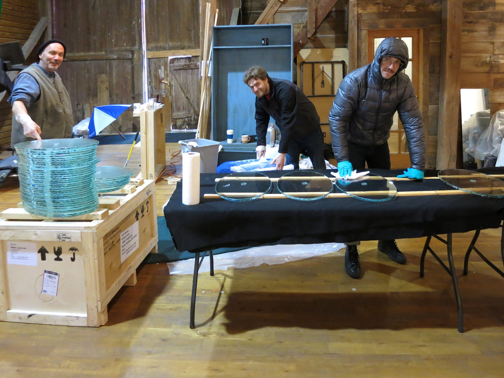 Danny, our installer Dan, and the rest of Danny's team cleaning and getting the glass pieces ready to put together.