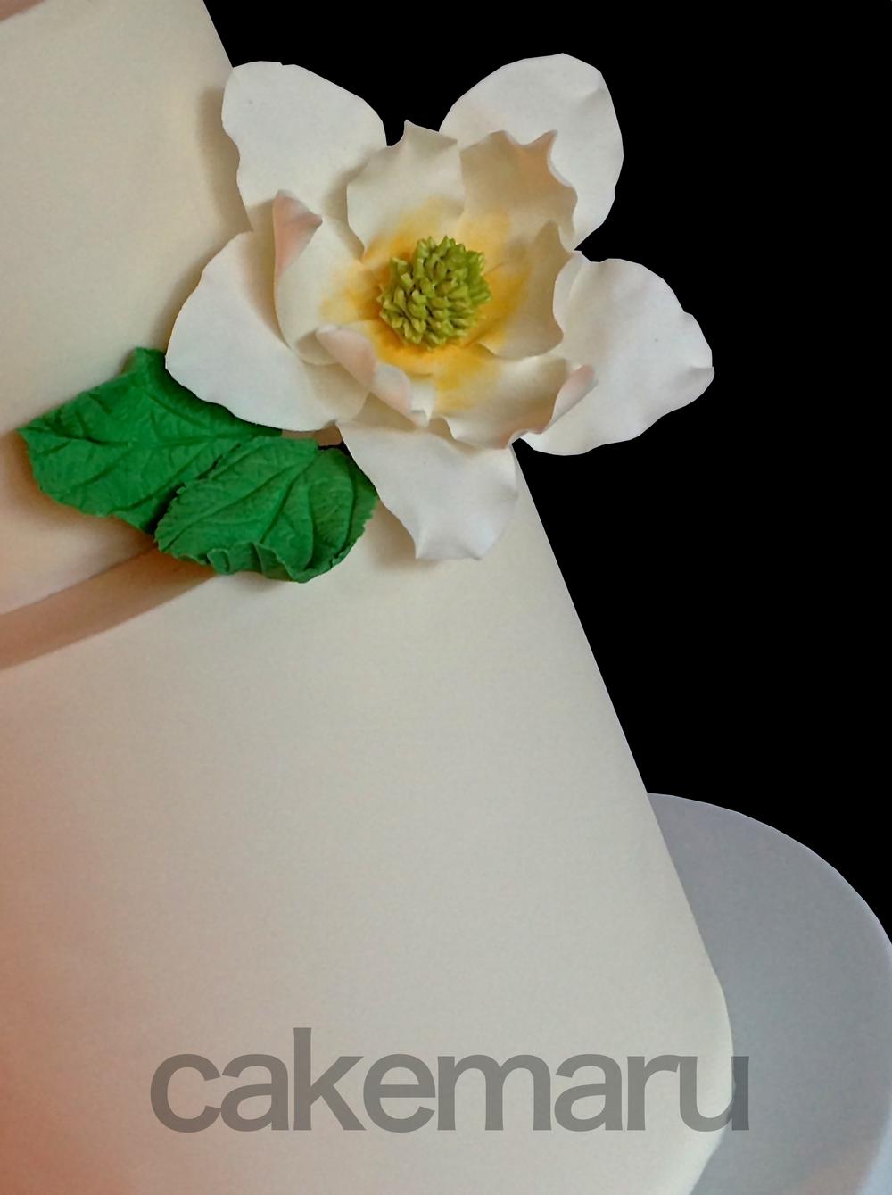 Magnolia cake with name.jpg