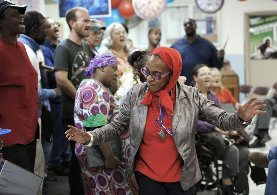 "Vernon Bryant/DMN Staff Photographer Malaika Abdul-Rahman of the Dallas Street Choir danced as her group sang ""This Little Light of Mine"" during a celebration of the Stewpot's 40th anniversary. With services that now include a medical and dental clinic, the Stewpot assisted more than 10,000 people in 2014."