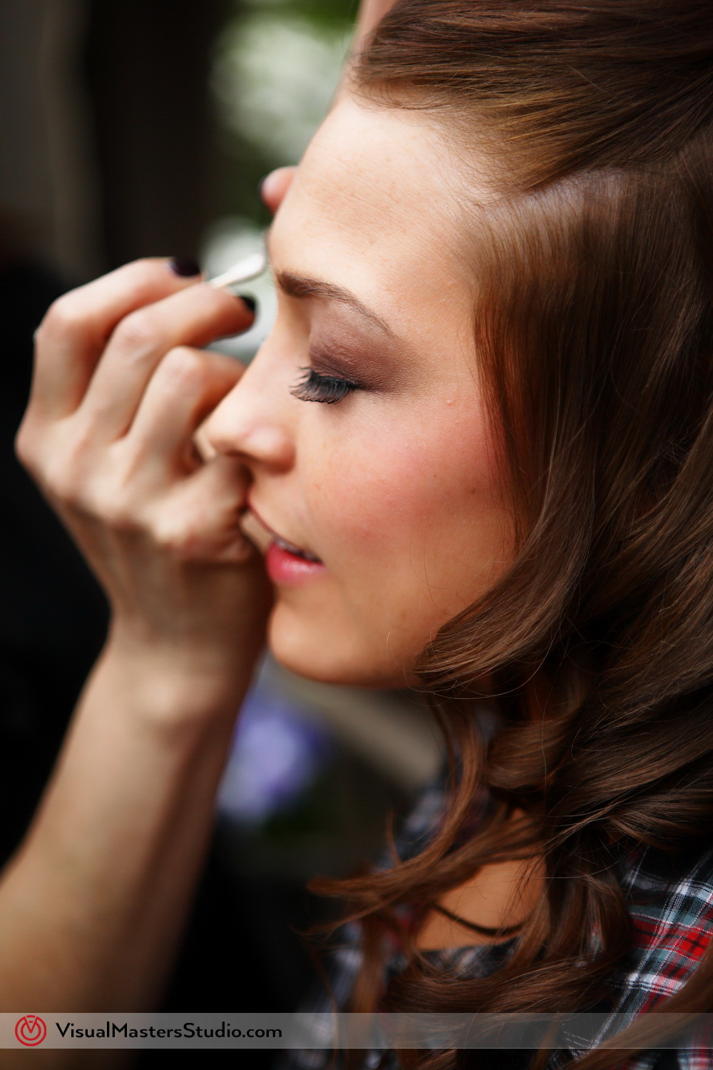 Bride doing her make up