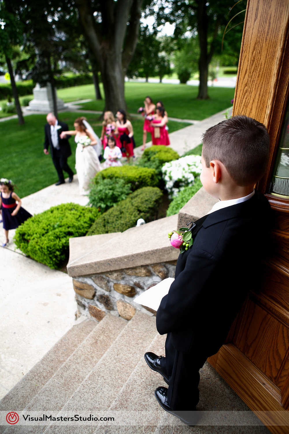 Ring bearer spying on wedding party
