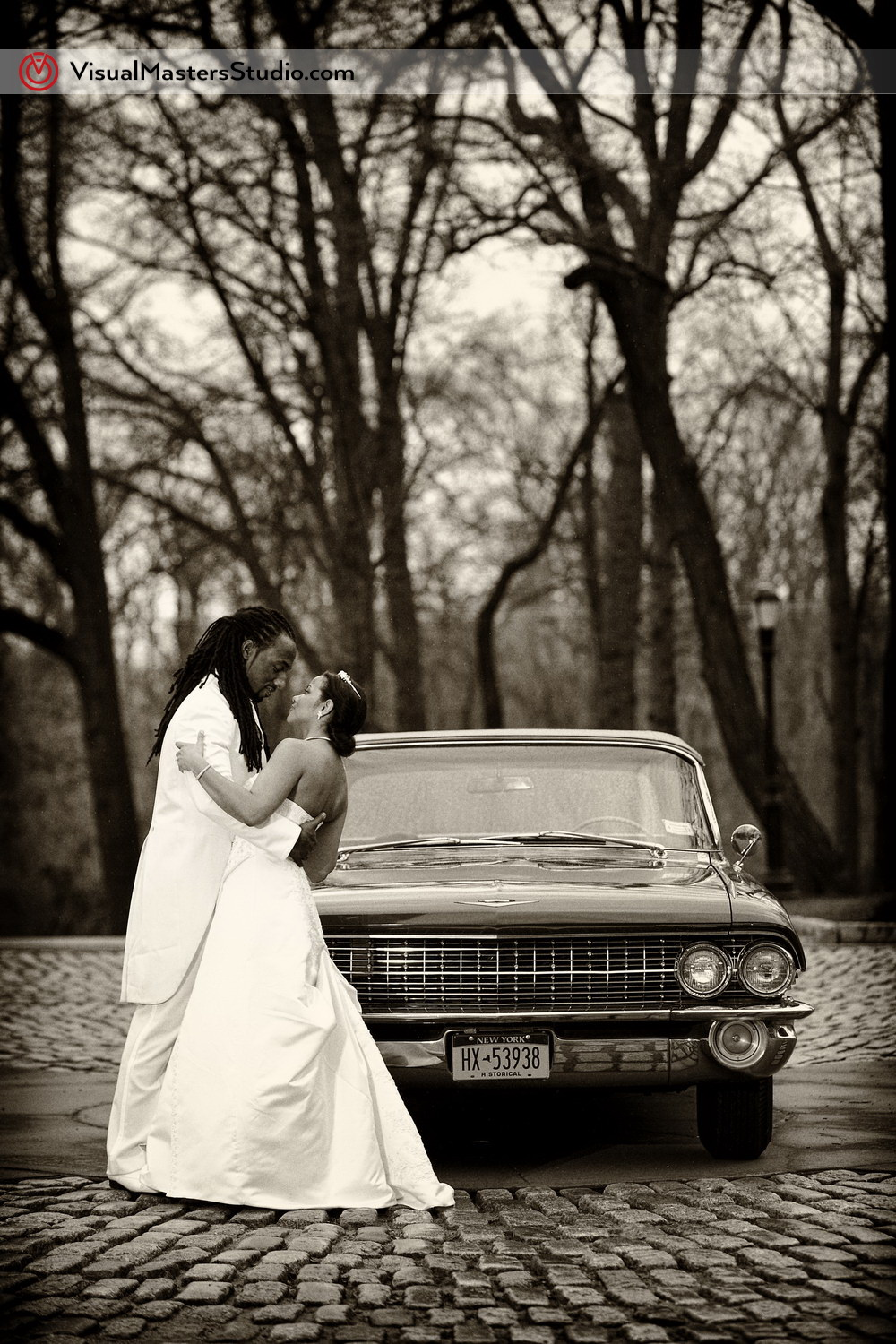 Bride and Groom Posing Next to Impala by VisualMasters