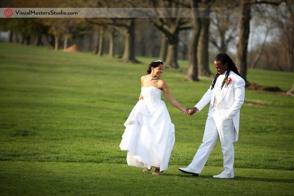 Bride and Groom walking at Pelham Bay & Split Rock Golf Course by VisualMasters