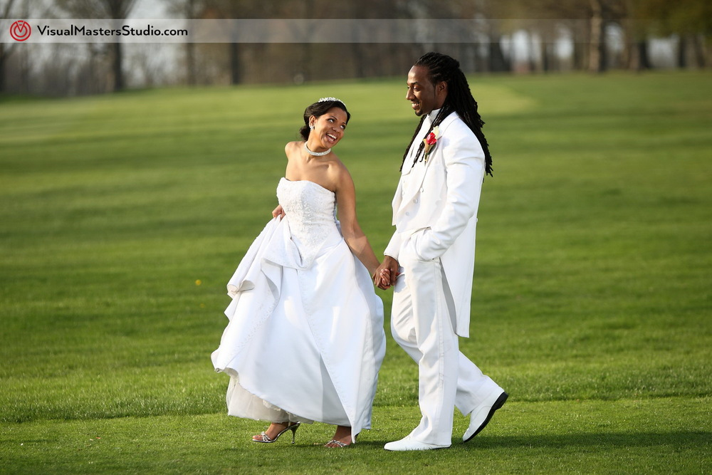 Bride and Groom talking a stroll at Pelham Bay & Split Rock Golf Course by VisualMasters