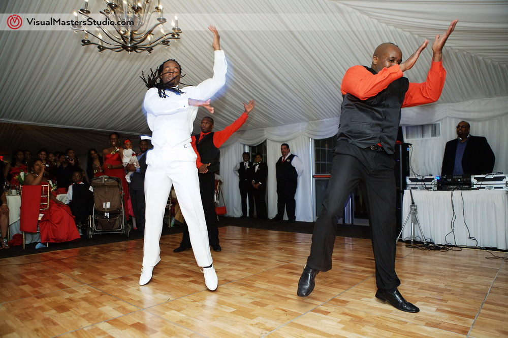 Groom and Groomsman dancing at Pelham Bay & Split Rock Golf Course by VisualMasters