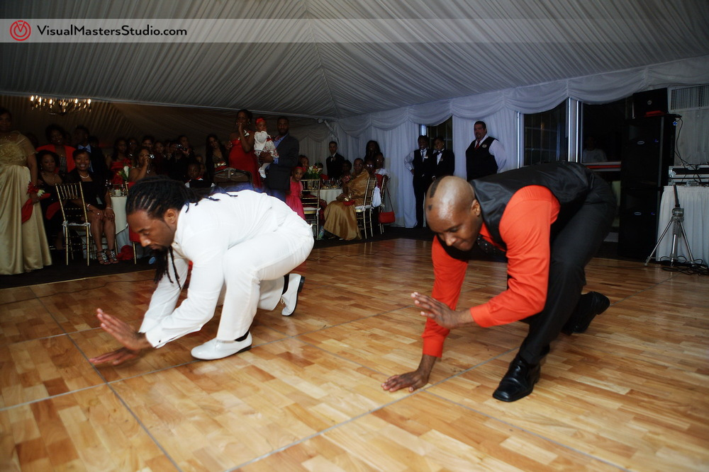 Groom and Groomsman showing of moves