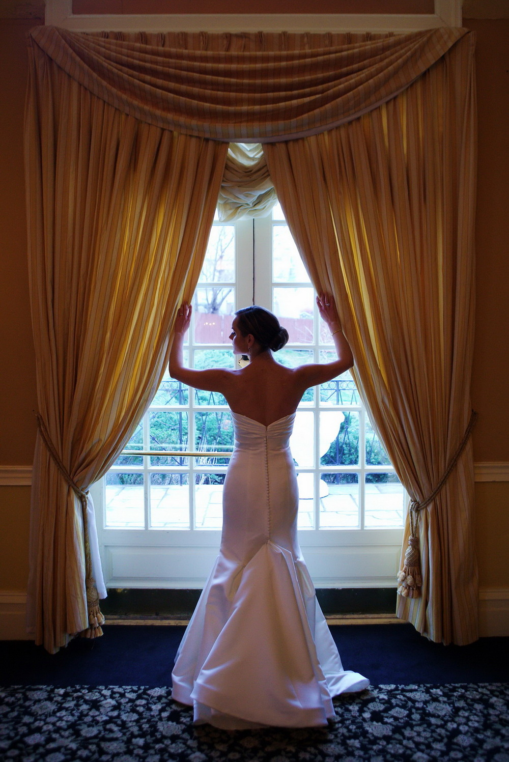 Bride by the window at Stony Hill Inn by Visual Masters