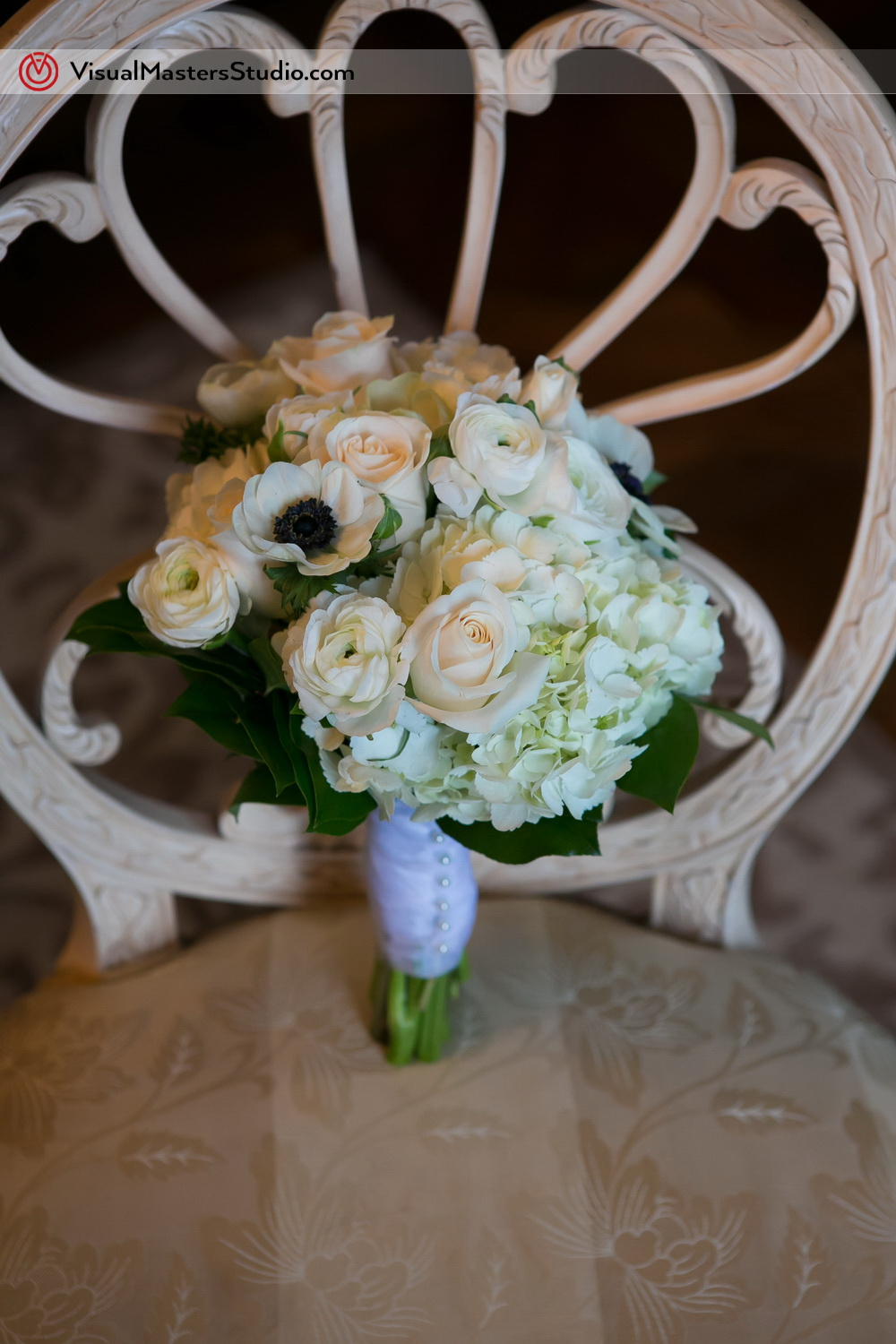 White Bridal Bouquet by Visual Masters