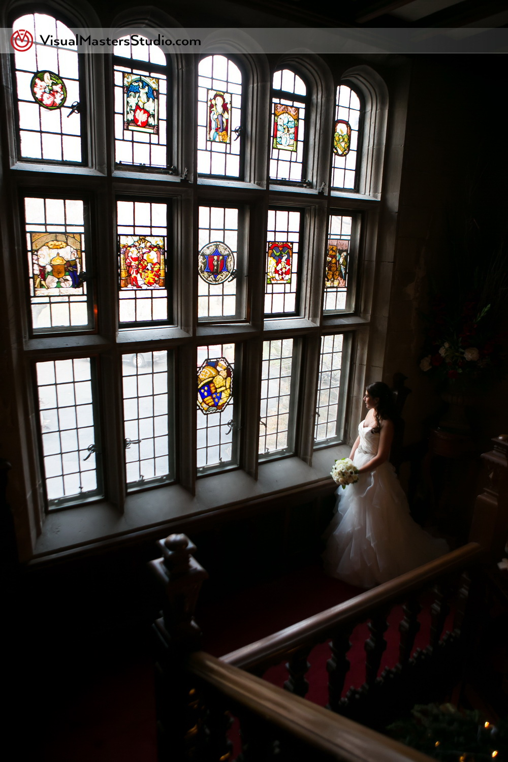 Bride Posing by the Window at The Castle at Skylands Manor by Visual Masters