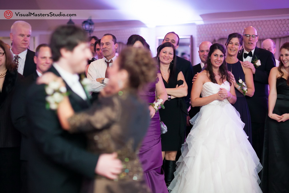 Groom dancing with his mom at The Castle at Skylands Manor by Visual Masters