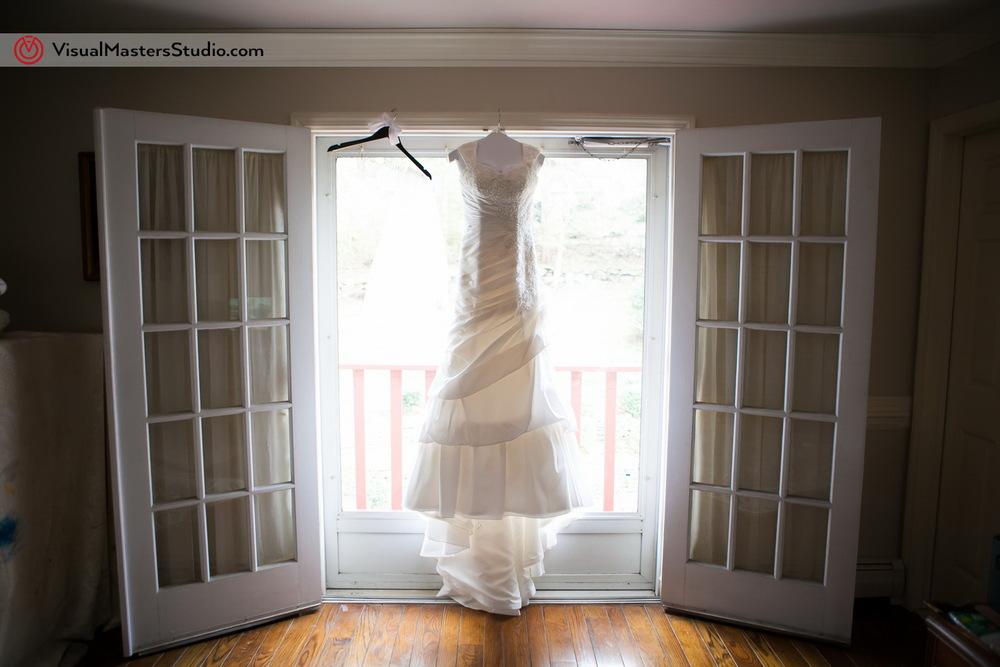 Wedding dress in the wondow by Visual Masters