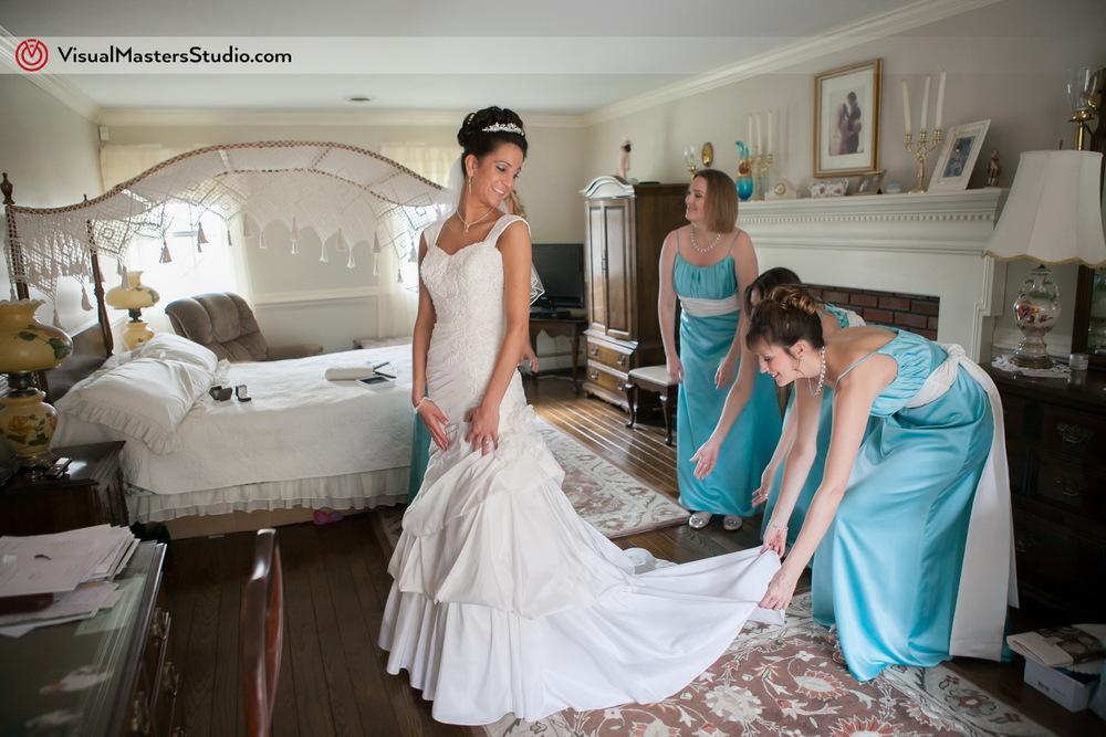 Bridesmaids Helping by Visual Masters