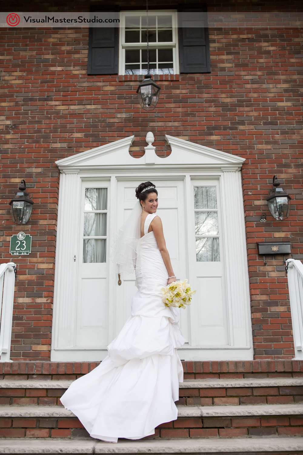 Bride Infront of her House by Visual Masters
