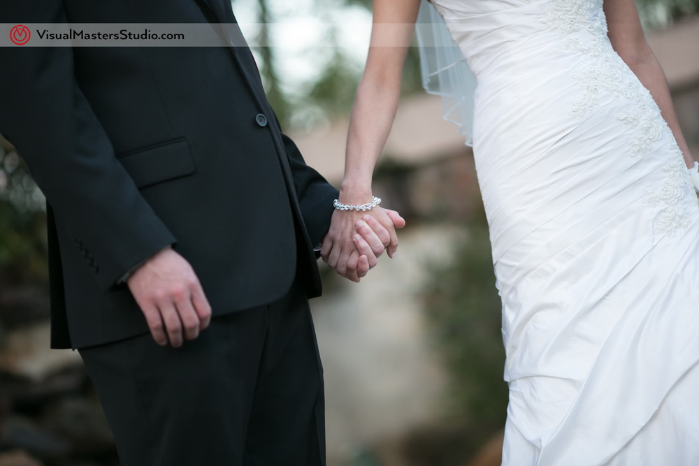 Newlyweds holding Hands by Visual Masters