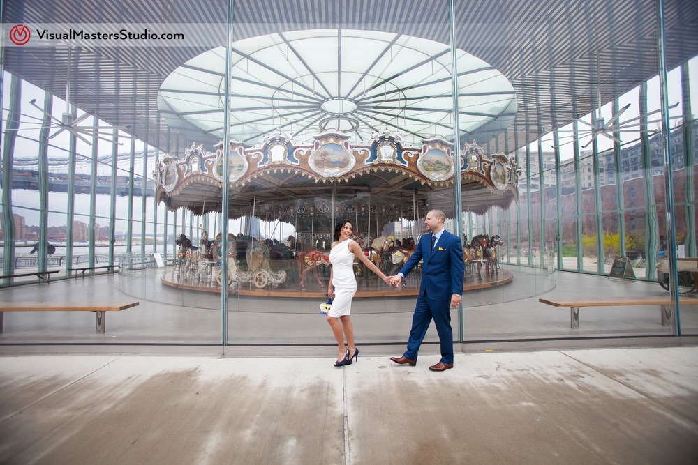 Bride and Groom by the Carousel Brooklyn Elopement by Visual Masters