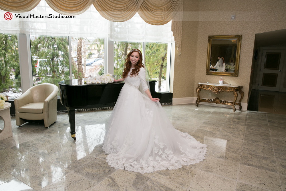 Bride Posing by the Piano by Visual Masters