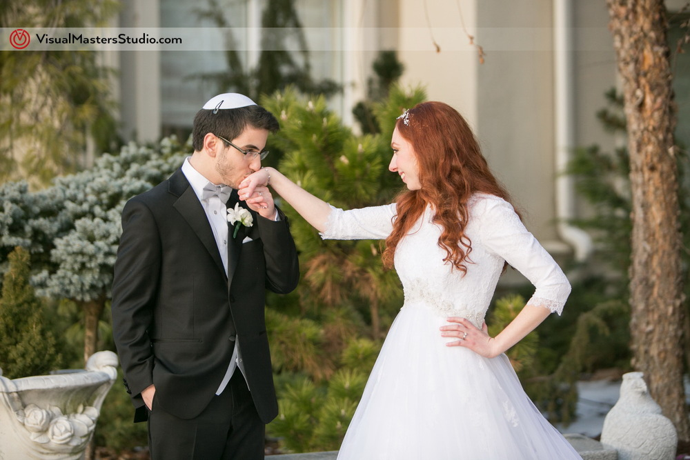 Groom Kissing the Brides Hand at The Wilshire Grand by Visual Masters