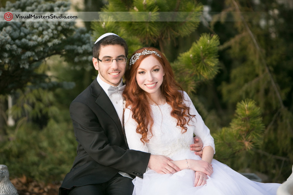 Bride and Groom in the Park at The Wilshire Grand by Visual Masters