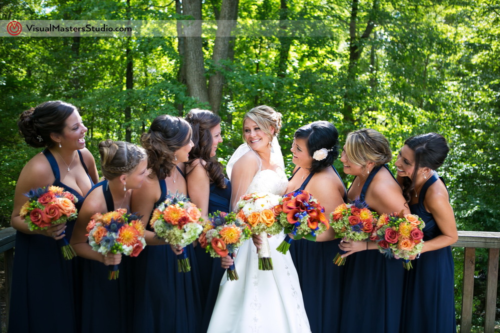Posing With Bridesmaids by Visual Masters
