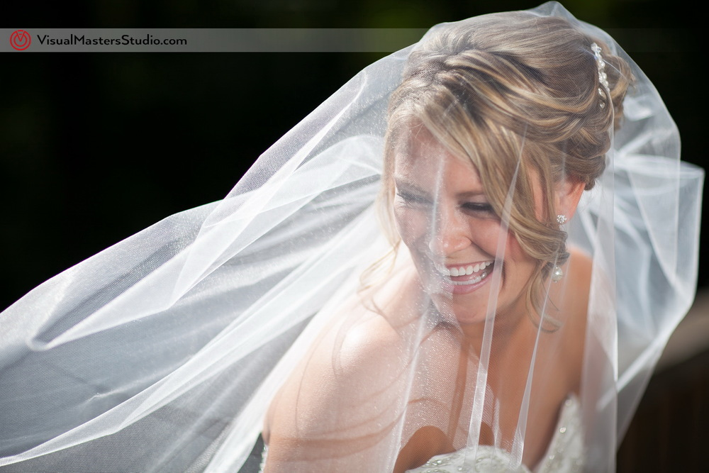 Candid Portrait of the Bride by Visual Masters