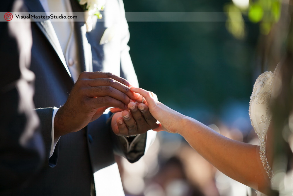 Ring Exchange  at Outdoor Ceremony by Visual Masters