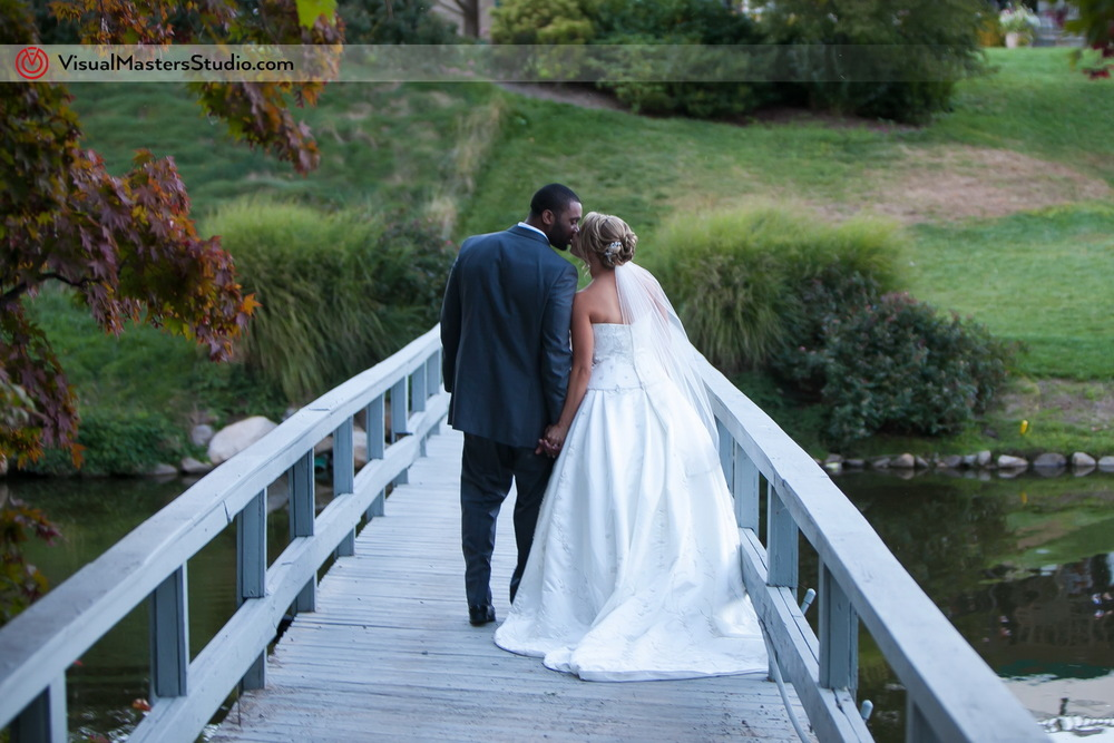 Bride and Groom Walking Away at Preakness Hills Country Club by Visual Masters