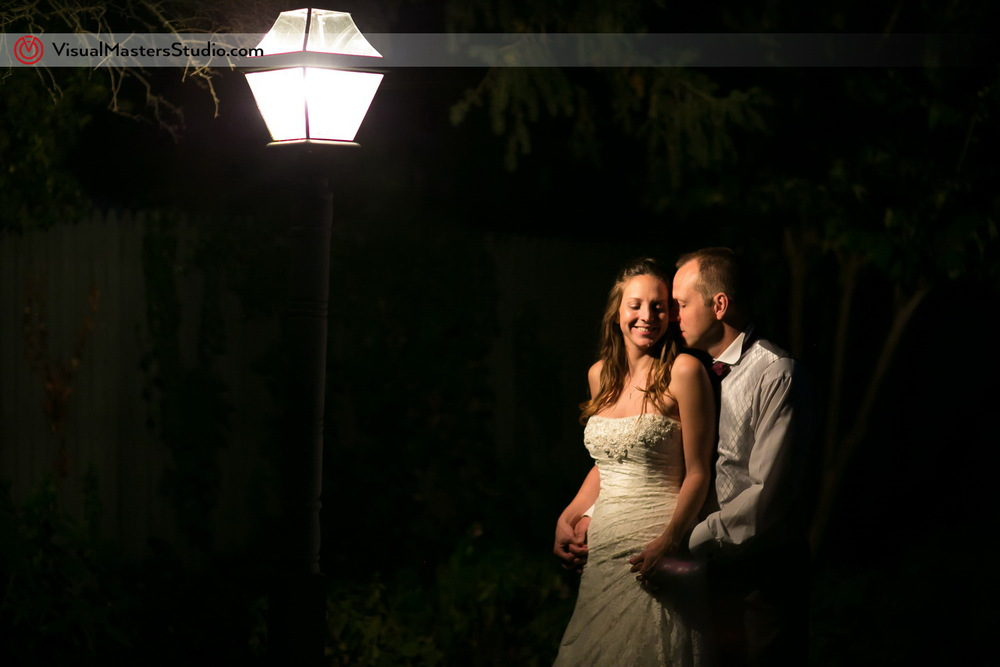 Bride and Groom under the street light by Visual Masters