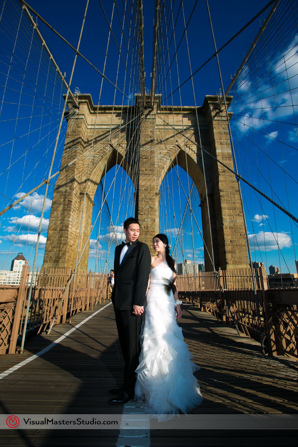 Bride and Groom on Brooklyn Bridge by by Visual Masters