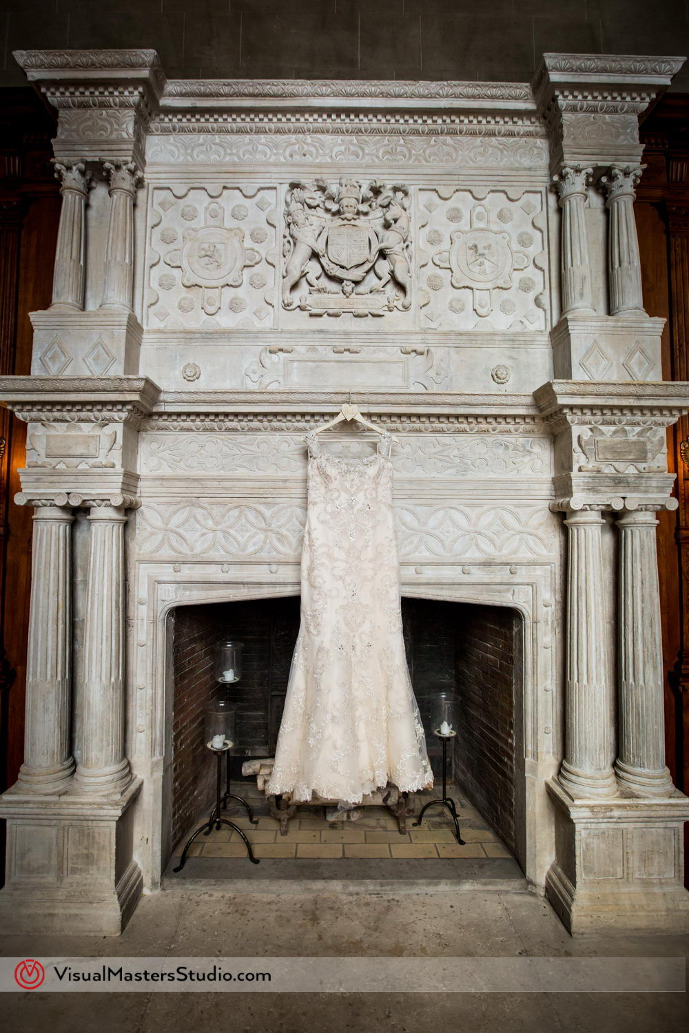 Wedding Dress by the Fireplace at Skylands Manor by Visual Masters