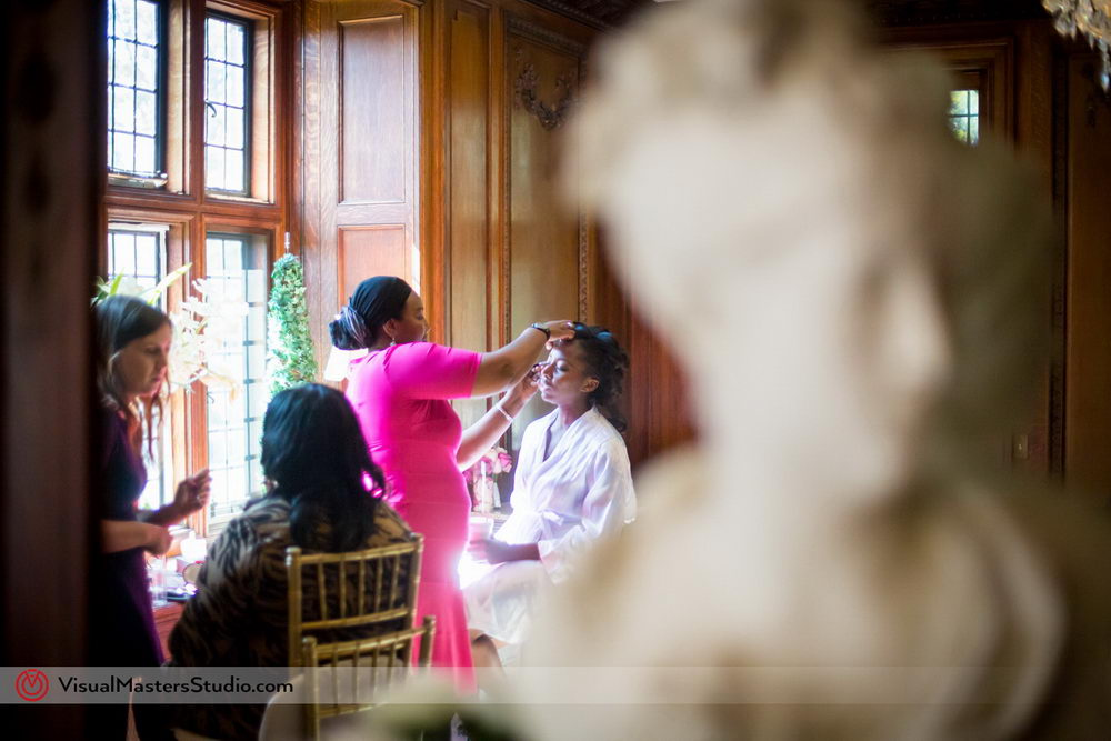 Candid of the Bride Getting Ready at Skylands Manor by Visual Masters