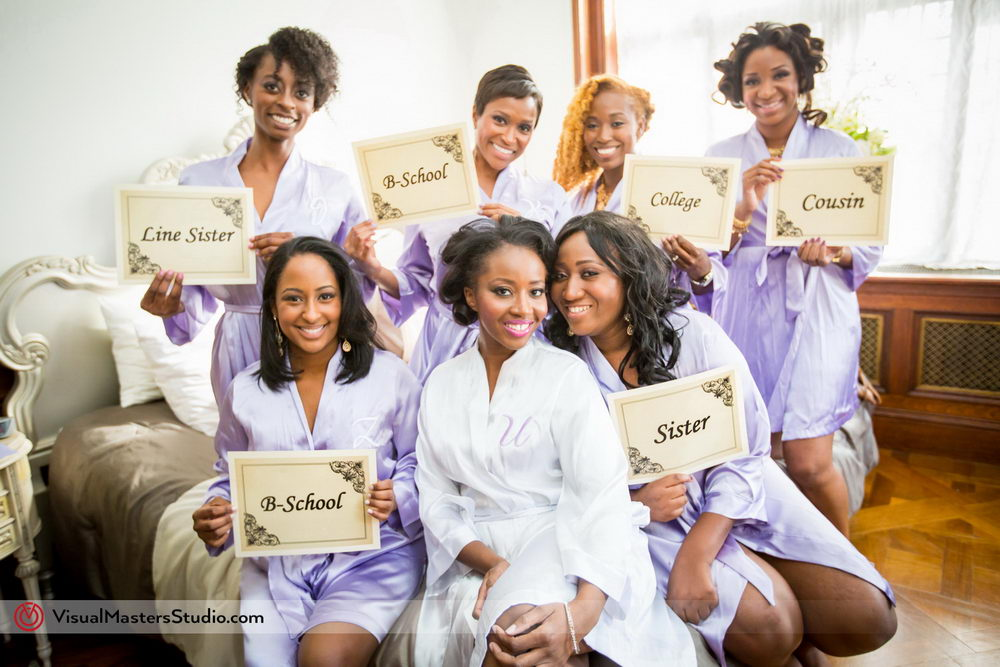 Bride and Bridesmaids Posing in Robes by Visual Masters